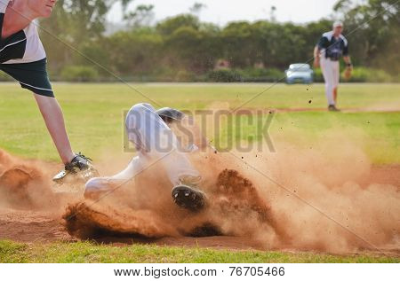 Baseball Player Sliding Into Third Base