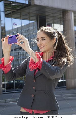 Woman Photographing With Mobile Phone.