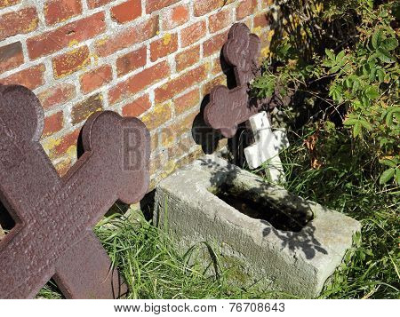 Old Grave Crosses On A Village Cemetery