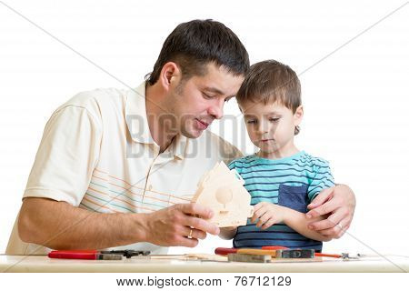 Dad and son kid teach building nesting box