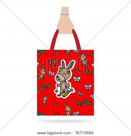 Hand With Christmas Shopping Bag