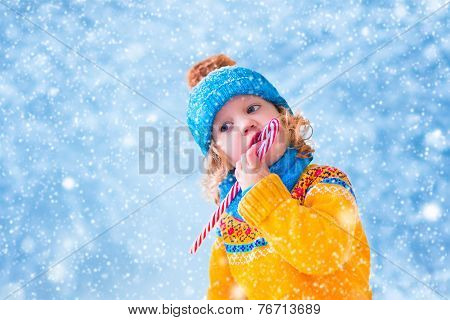 Sweet Little Girl In Snowy Park