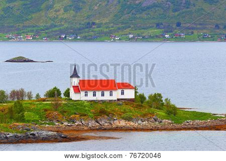 Norway, fjord.Lofoten Islands. Catholic church.