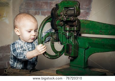 Boy Turning The Machine's Wheel