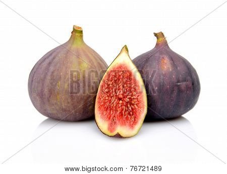 Three Figs With Quarter Isolated On White Background