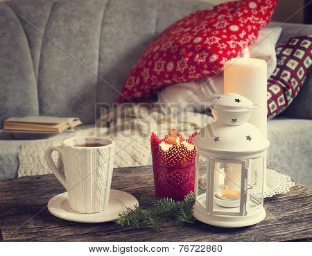 Still Life Interior Details, Cup Of Tea, Candles Near The Sofa With Pillows.