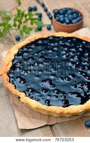 Blueberry Pie And Fresh Berries On Rustic Wooden Table