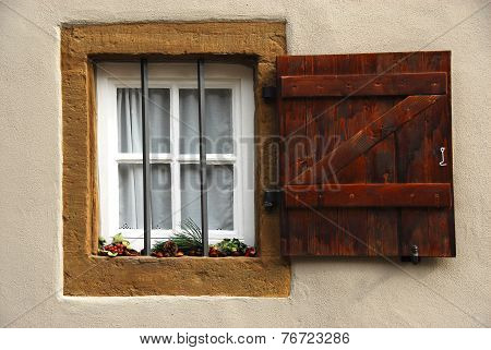 Old mullioned windows with wooden shutters