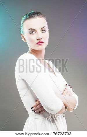 Portrait Of Serious Brunette Woman Over Gray Background