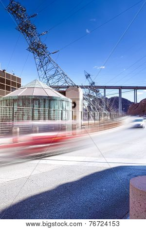 Cars Passing By Over The Hoover Dam At Noon