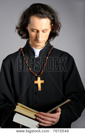 Conceptual Portrait Of Praying Priest