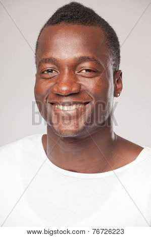 Close up Portrait of a african man on gray background
