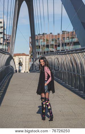 Beautiful Young Brunette Posing On A Bridge