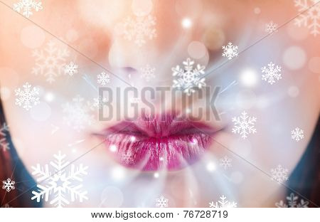 Pretty woman mouth blowing cold breeze close up