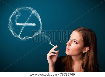 Pretty young lady smoking unheathy cigarette with no smoking sign