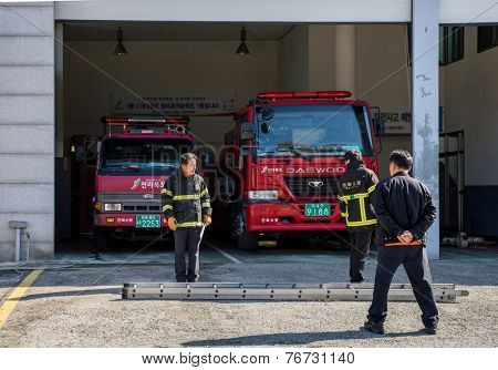 JEONJU, SOUTH KOREA - 3 NOVEMBER 2014: Firefighters prepare to start morning drills and practices in a fire department station in the Jeonju traditional Korean Hanok village.