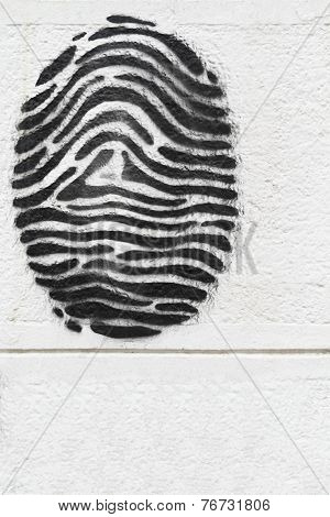 Drawn Fingerprint On A White Wall