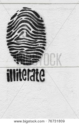 Fingerprint On A White Wall- Symbol Of Illiteracy