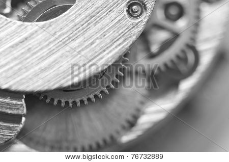 Black And White Background With Metal Cogwheels A Clockwork. Conceptual Photo