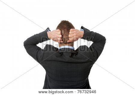 Back view businessman putting hands on the nape.