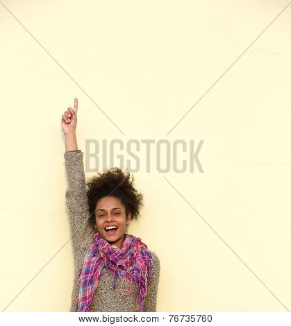 Carefree Young Woman Pointing Finger Up