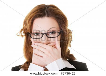 Businesswoman covering her mouth because of shame.