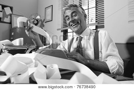 Cheerful Vintage Accountant Surrounded By Bills