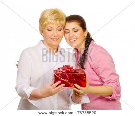 Daughter giving gift to her mother isolated