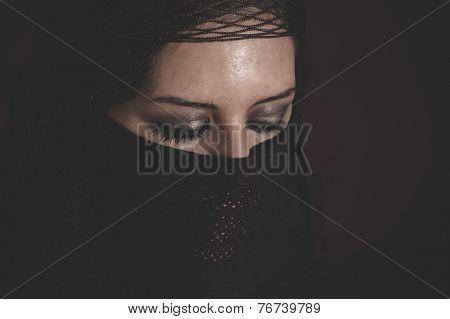 woman in traditional Islamic veil, burka, beautiful and deep look