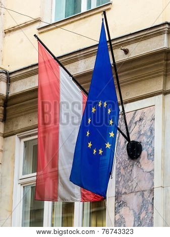 the european union (eu) flag and the austrian flag.