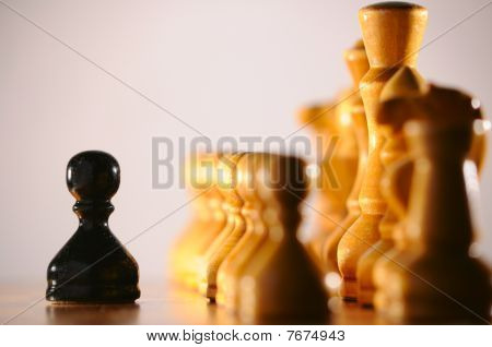 Black Pawn Against White Chess Pieces Army