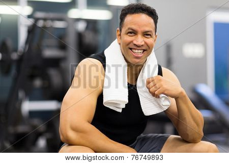 portrait of handsome sportive man in gym