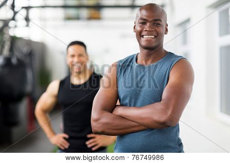 portrait of confident african male gym trainer