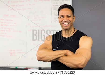 portrait of handsome middle aged gym coach