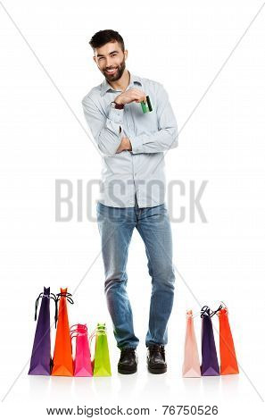 Handsome Smiling Man With Shopping Bags And Holding Credit Card