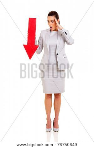 shocked young businesswoman holding red arrow pointing down