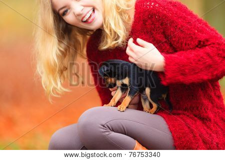 Woman Embrancing Her Puppy Dog
