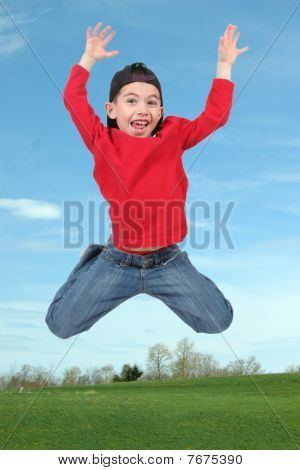Little Boy Jumping In Air