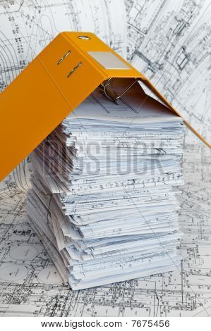 Big Heap Of Design And Project Drawings Under Yellow Folder