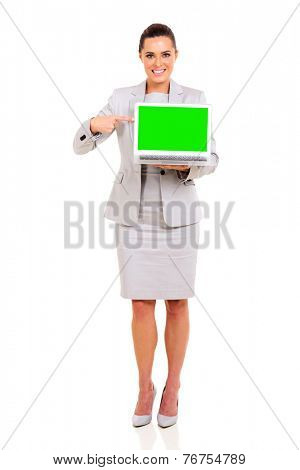 beautiful young business woman pointing laptop green screen