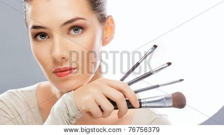 beautiful girl holding a brush