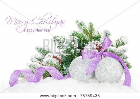 Christmas baubles and purple ribbon with snow fir tree. Isolated on white background with copy space