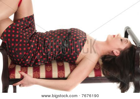 Young Beautiful Girl In Dress On Sofa. Isolated On White Background