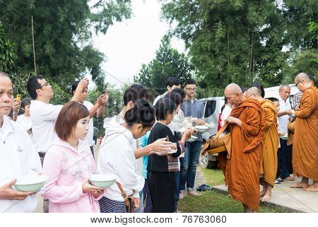 People Put Food Offerings In A Buddhist Monk's Alms Bowl To Make Great Merit