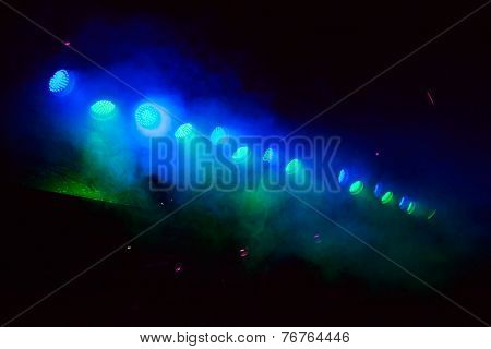 glowing blue and green spotlights. background