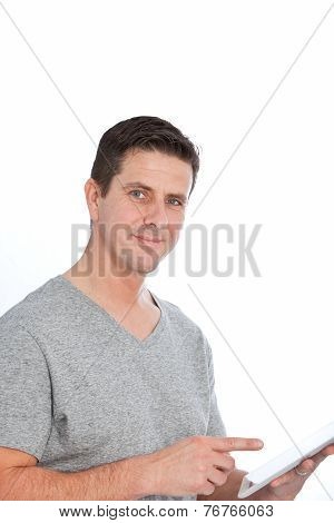 Handsome Man In Gray Shirt With Tablet Computer