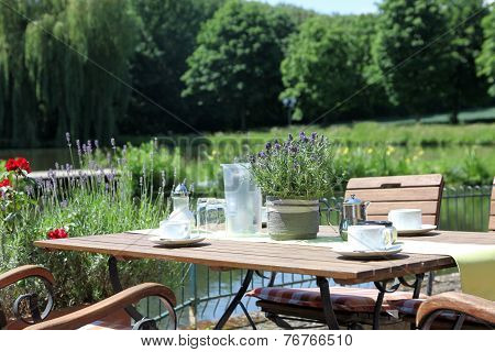 Outdoor Table Beside Lake Set For Morning Coffee