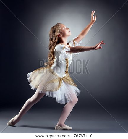 Lovely little ballerina dancing at camera