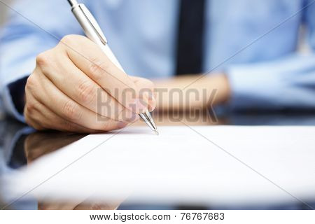 Business Man Signing The Contract To Finalize A Deal