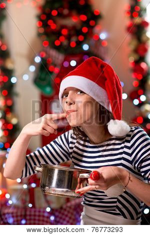 Woman tasting something tasty on Christmas